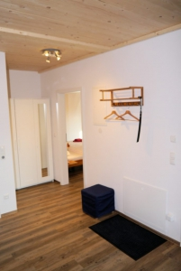Apt. 1 Entrance area with a coat rack.