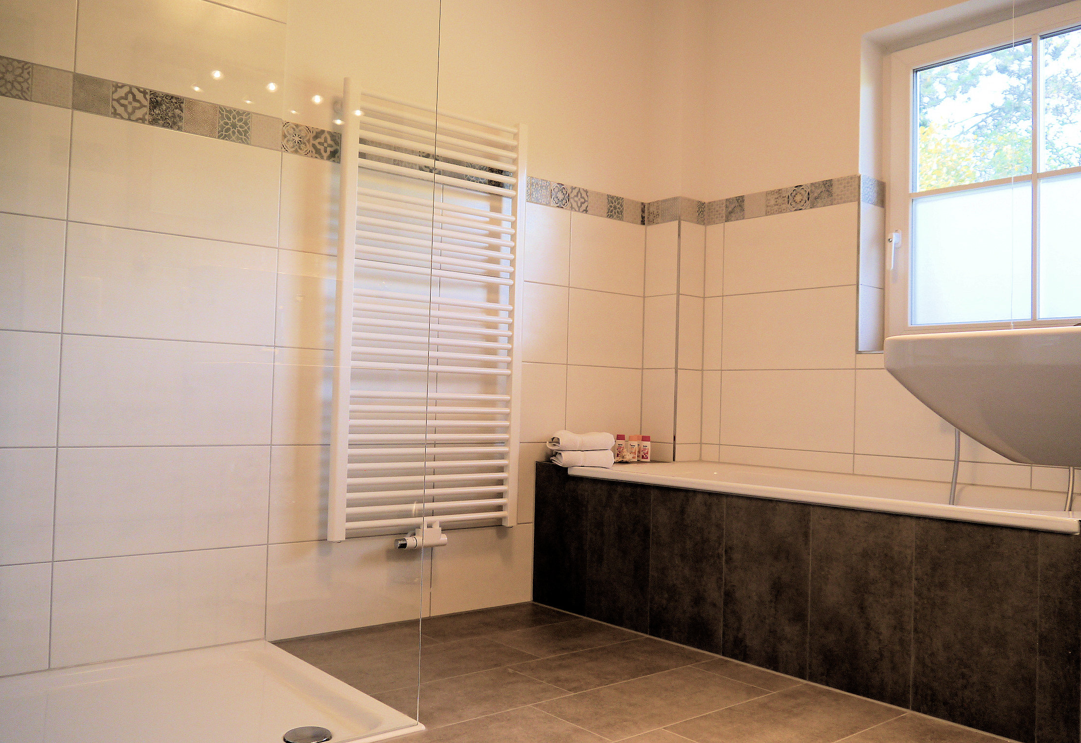 Our spacious bathroom with bath tub and shower.