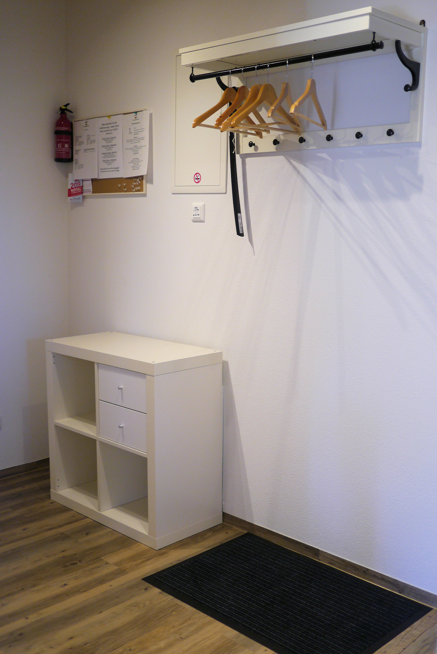 Apt. 2 Entrance area with a coat rack.