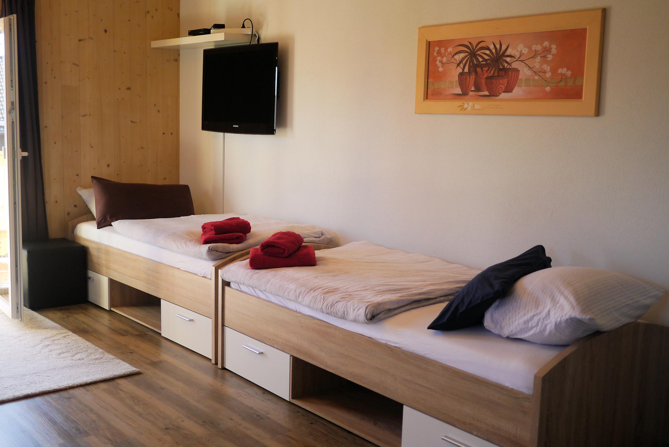 Apt. 2 Der Wohnbereich bietet weitere Schlafmöglichkeiten.
